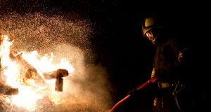 Firefighter tackling a blaze
